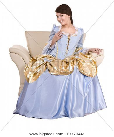 Girl in old  long blue with gold dress on armchair. Isolated.