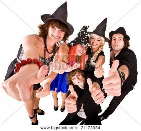 Group of people in  witch costume with thumb up.  Isolated.