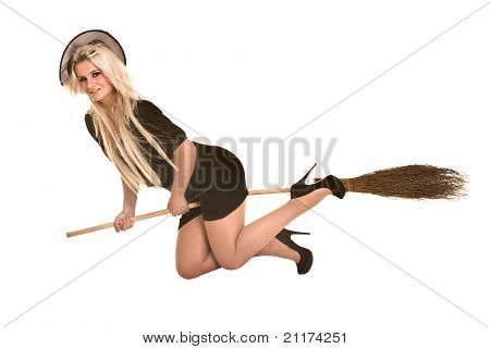 Halloween witch blond in black costume and hat fly on broom.Isolated.