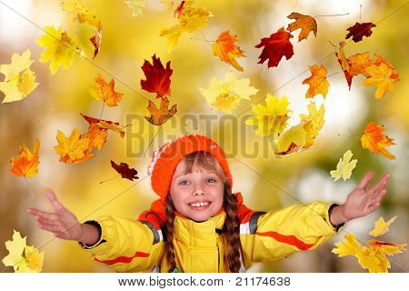 Girl child in autumn orange hat with outstretched arm.  Outdoor.
