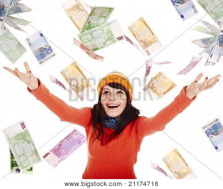 Girl in autumn orange sweater, hat  with flying money euro.Isolated.