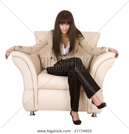 Beautiful girl with long hair sitting in armchair. Isolated.