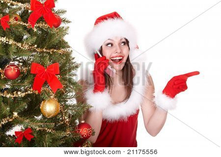 Christmas girl in santa hat call mobile phone, fir tree. Isolated.