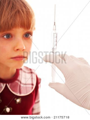 Child look at hand with syringe. Medicine.