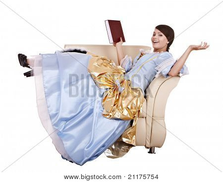 Girl in blue lond dress with book on chair.Isolated.