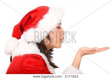 weibliche Santa blasen ihre hand