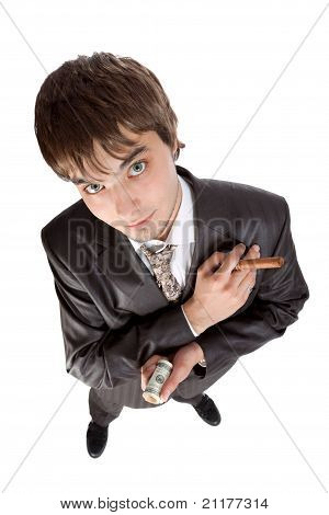 Young Businessman Holding Money And A Cigar Isolated On White