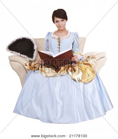 Girl in blue longd dress with book on chair.Isolated.