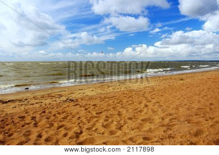 Seashore. Hot Sand. Dark Blue Sky.