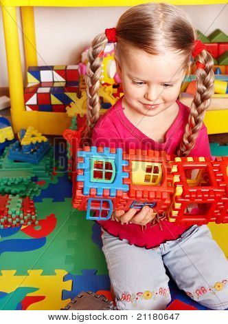 Child  preschooler play block and construction set in playroom.