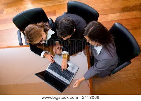 Business Team In An Office Laptop
