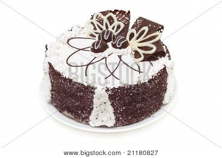Beautifully Decorated Cake With White And Dark Chocolate Isolated On White