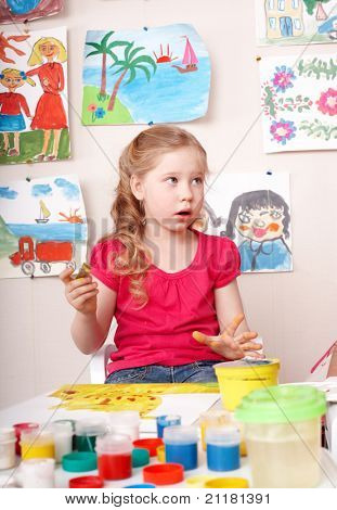 Little girl paint picture in preschool.