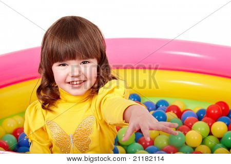 Child in group of colourful ball. Isolated.