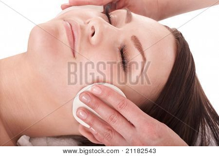 Beautiful young girl in spa. Facial massage.