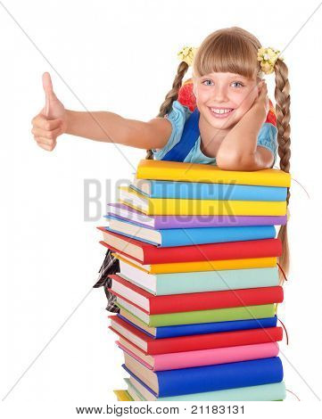 Schoolgirl with pile of books and showing thumb up. Isolated.