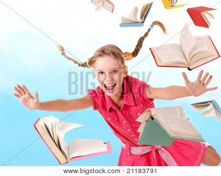 School girl  holding pile of books. Outdoor.