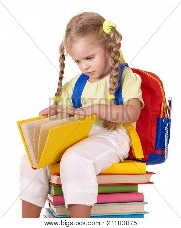 Little girl sitting on pile of books. Isolated.