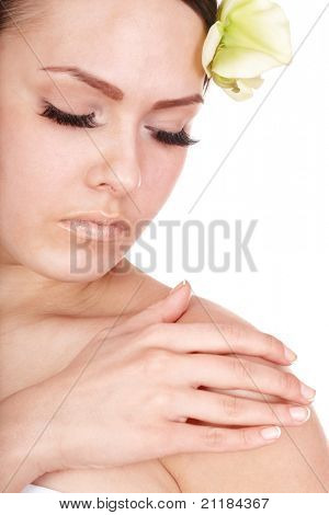 Beautiful girl with orchid flower. Isolated.