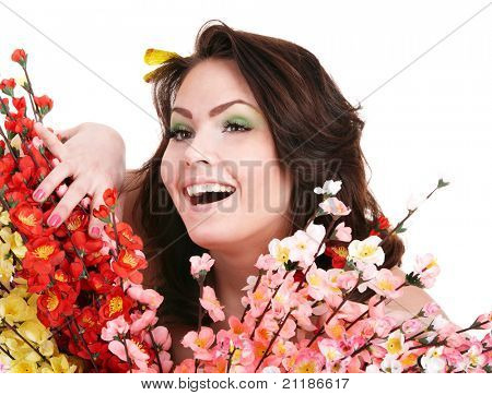 Beautiful young woman with spring flower and butterfly.