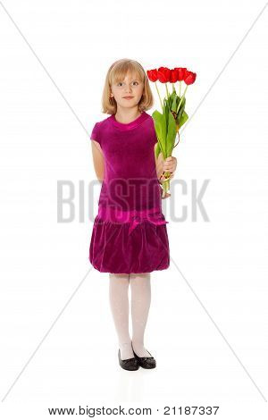 Cute Girl Giving A Bouquet Of Tulips