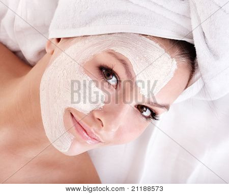 Young woman with clay facial mask.