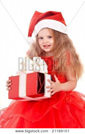 Little girl in red santa hat holding gift box. Isolated.