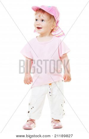 Cute Baby Girl In A Pink Cap Looks Up Isolated On White