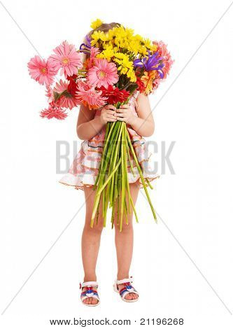 Little girl holding bunch of flowers.