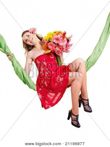 Beautiful  young woman holding  flowers on swing.