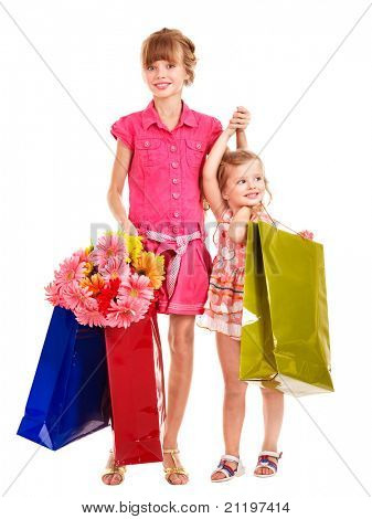 Happy little girl with shopping bag. Isolated.