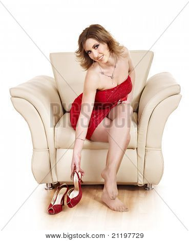 Beautiful girl  sitting in armchair. Isolated.
