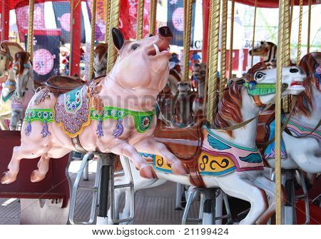 Pigs And Horses On Carousel