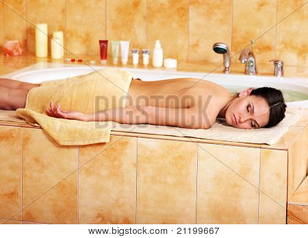 Young woman in hammam or turkish bath.