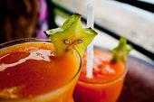 picture of fruit-juice  - A couple of glasses of Maracuya, passion fruit, juice