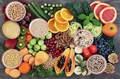 Health food concept for a high fiber diet with fruit, vegetables, cereals, whole wheat pasta, grains poster