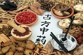 Herbs used in chinese herbal medicine with moxa sticks used in alternative moxibustion therapy. Call poster