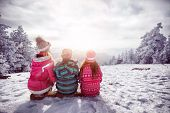 Ski, winter, snow and fun - family enjoying winter together poster