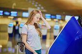 Tourist Girl With Backpack In International Airport poster
