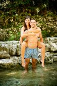 Active Young Couple Chilling Out In River  On A Hot Summer Day Standing And Walking In Water poster