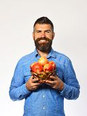 Farmer With Happy Face Holds Red Apples. poster