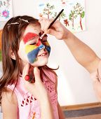stock photo of face painting  - Child preschooler with face painting - JPG