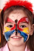 picture of face painting  - Little girl  making face painting - JPG