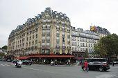 French People Walking Beside Road And Traffic Road Front Of Gare De Paris-est Or Paris Gare De Lest poster