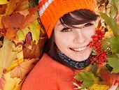 Girl in autumn orange leaves.  Outdoor.