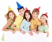 picture of young adult  - Group of young people in party hat holding banner - JPG
