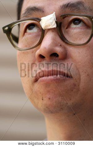 Asian Man In Broken Glasses