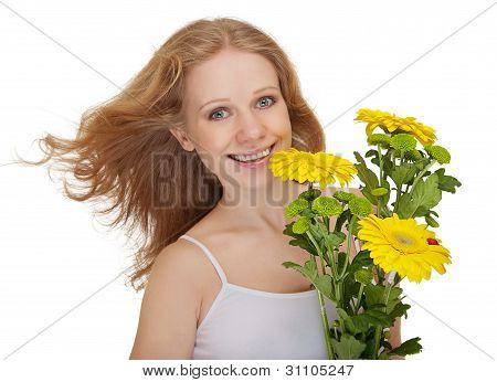 Beautiful Smiling Girl With Flowing Hair Holding A Bouquet Of Yellow Flowers Gerbera Isolated
