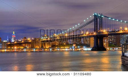 Manhattan Bridge Spanning the East River towards Manhattan and the Empire State Building.
