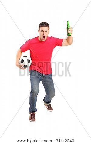 Full length portrait an euphoric fan holding a beer bottle and football cheering isolated on white background